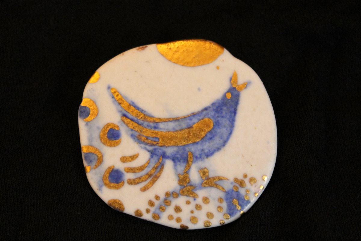 Porcelain gold plated brooch
