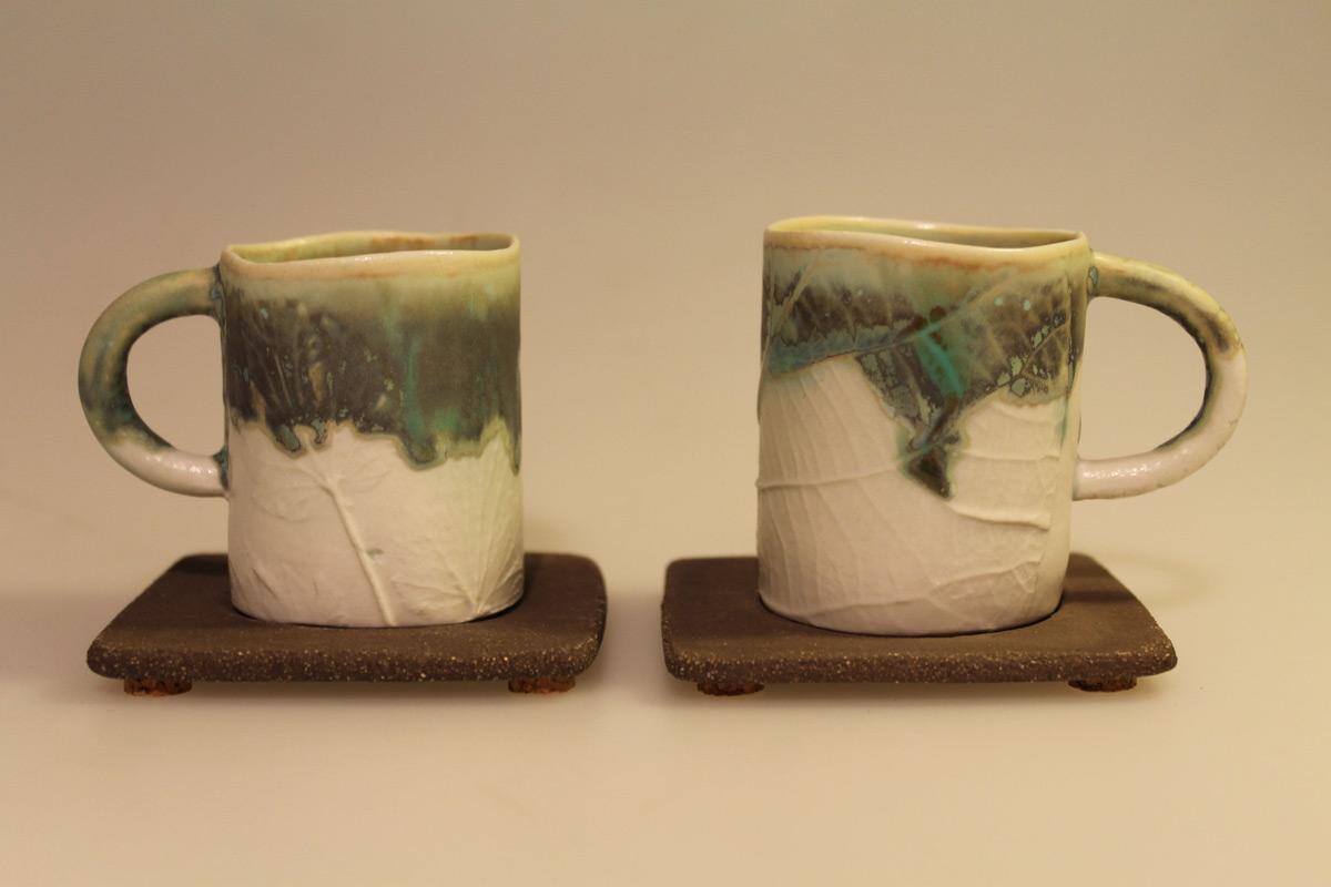 Porcelain Espresso Cups On Stoneware Plates